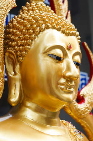 The side face of sitting gold buddha in Bangkok,Thailand Stock Photo - 18652462