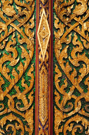 The door of chapel have the beautiful Thai style pattern Stock Photo - 18813055