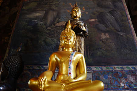 The different style  of buddha statue in the chapel of Wat Suthat Walaram in Bangkok,Thailand photo