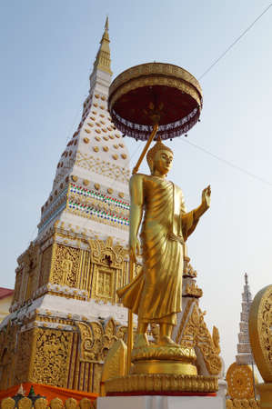 The standing buddha image in Wat Mahathat temple at Nakhonpanom, Thailand photo