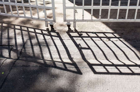 dirty: shadow from fence on street