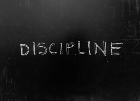 Disziplin handschriftlich auf Tafel stockfoto als JPG-Datei