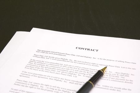 close-up of contract and pen (shallow focus) photo