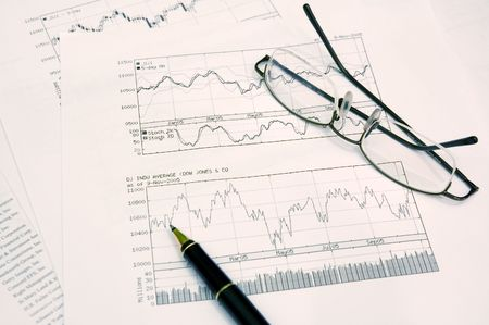 buy shares: graphs, pen and glasses Stock Photo