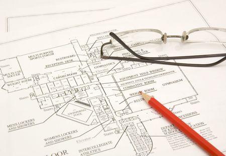 draftsman: draftings, red pencil and glasses