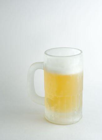 pilsner: A mug of ice-cold beer in white background