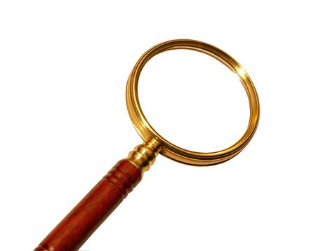antique magnifying glass over white photo