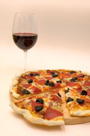 fresh pizza and glass of wine photo