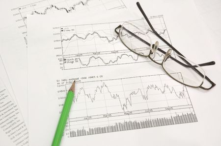 equities: stock graphs, pencil and glasses