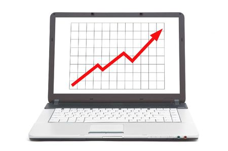 stockmarket: upwards going graph on the screen of notebook