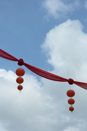 deng: chinese lanterns over blue sky Stock Photo