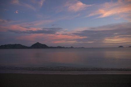 komodo island: pink sunset at komodo island