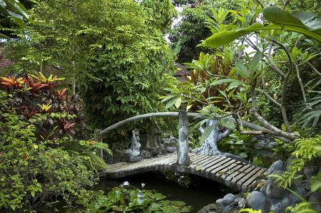 woden bridge in eastern garden photo