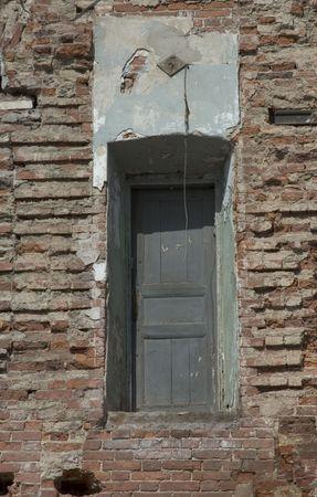 door of destroyed house photo
