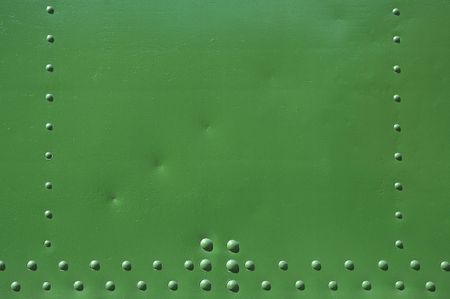 riveted green background with space for text photo