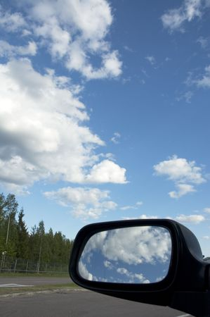 sky reflecting in rear view mirror Stock Photo - 427465