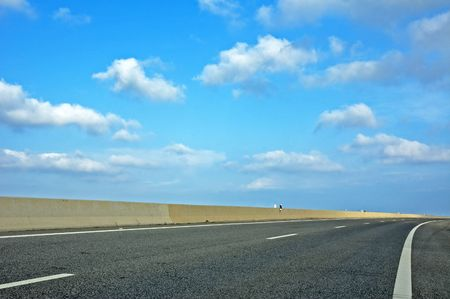cornering: highway and blue cloudy sky Stock Photo
