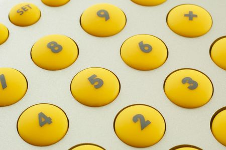 yellow buttons of calculator photo
