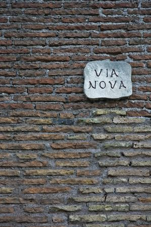 nameboard: ancient roman wall with street nameboard
