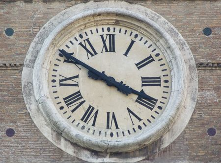 face of ancient clock photo
