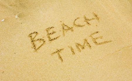 beach time written in the golden sand photo