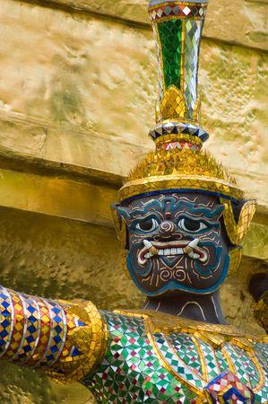 Statue of demon at Wat Phra Kaew, Bangkok photo