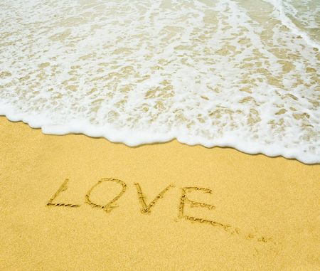 love written in a sand photo