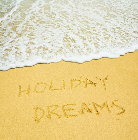 holiday dreams written in the sandy beach photo