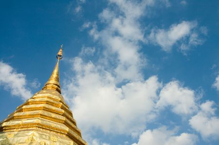 golden stupa over blue sky background with copyspace