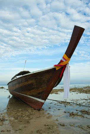 longtail boat in low tide, thailand photo