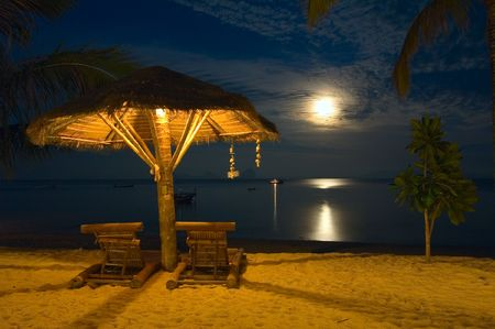 moon chair: beach chairs at tropical resort - night scene