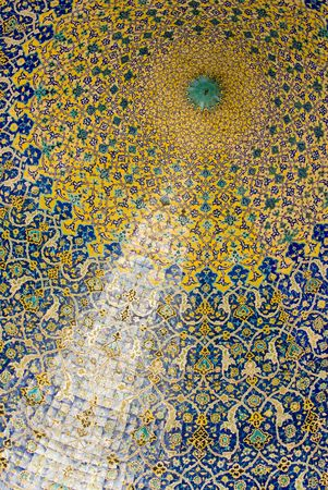 Motif on Dome of the mosque, oriental ornaments from Isfahan, Iran photo