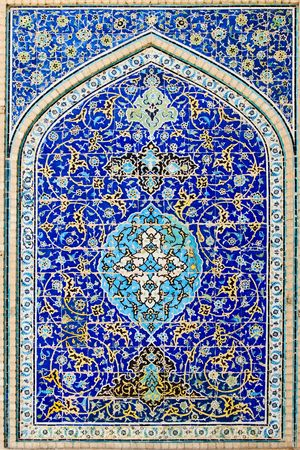 tiled background, oriental ornaments from Isfahan Mosque, Iran photo