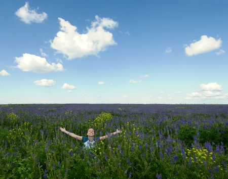 happy girl in the blooming field Stock Photo - 1297572