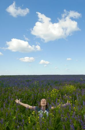 happy girl in the blooming field Stock Photo - 1319851
