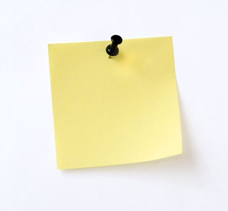 yellow note with black pin over white background