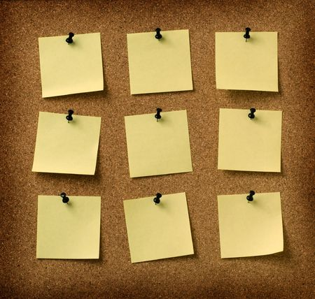 post it notes: nine yellow notes pinned to grunge cork background