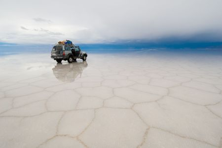 salar: car in the salt lake salar de uyuni, bolivia