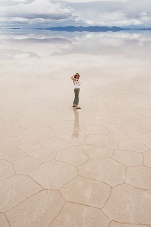 young woman staring, salar de uyuni salt lake, bolivia photo