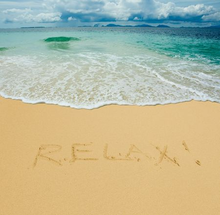 relax written in a sandy tropical beach photo