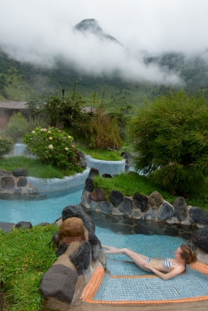 spa resort: young woman in thermal bath, highland spa resort Stock Photo
