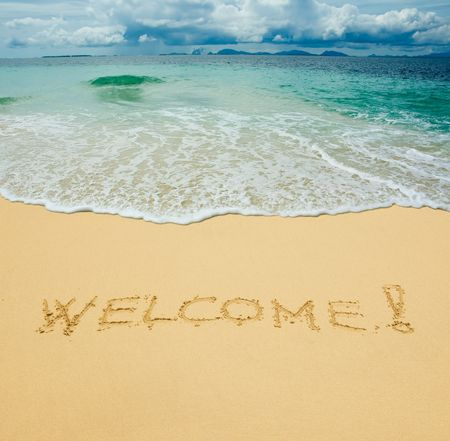 welcome written in a sandy tropical beach Stock Photo - 2682987