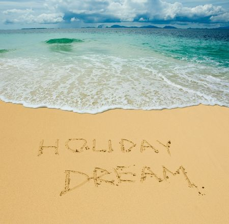 holiday dream written in a sandy tropical beach Stock Photo - 2704062