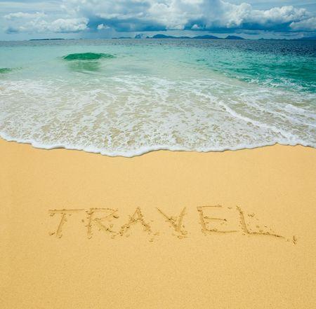 travel written in a sandy tropical beach Stock Photo - 2783082
