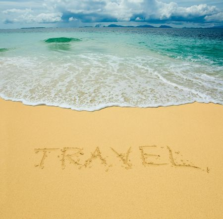 travel written in a sandy tropical beach Stock Photo - 2783082