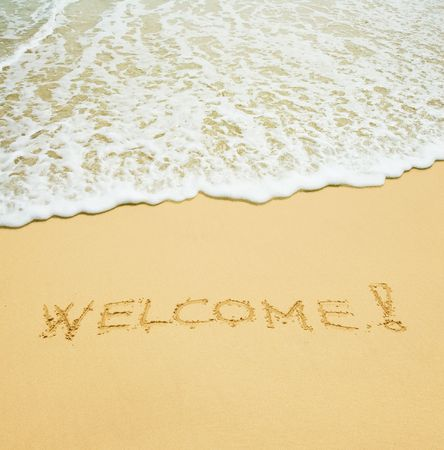 welcome written in a sandy tropical beach photo