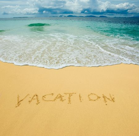 vacation written in a sandy tropical beach Stock Photo - 2954647
