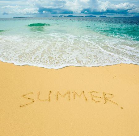 summer written in a sandy tropical beach photo