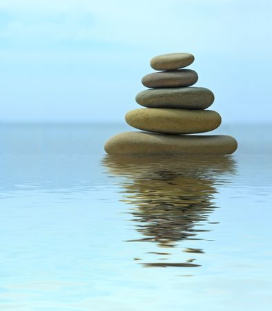 equilibrium: Pebble stack reflecting in the water