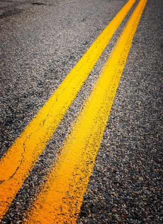 dividing lines: yellow dividing lines on the highway  Stock Photo
